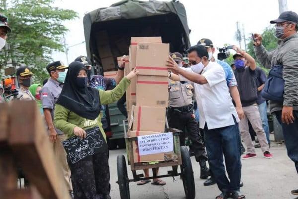 Dinas Sosial DKI Jakarta Urai Program Bansos Selama PSBB 109